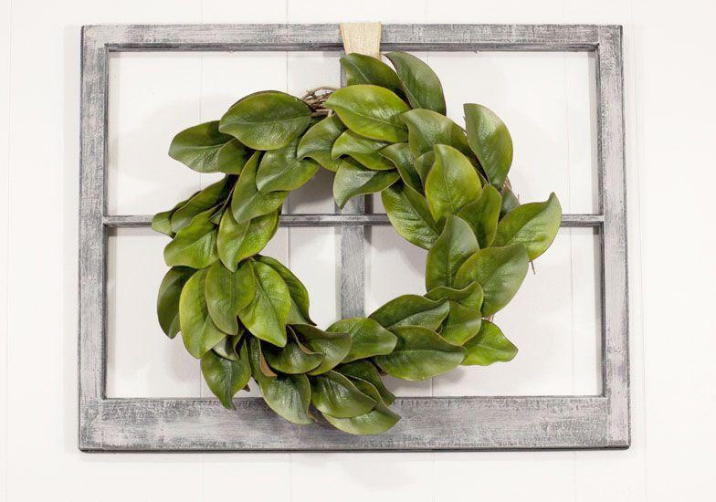 a wreath made of faux magnolia leaves