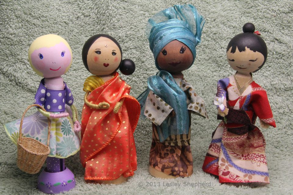 Clothespeg dolls in saree, kimono, gele, bubo and iro, and contemporary dress.