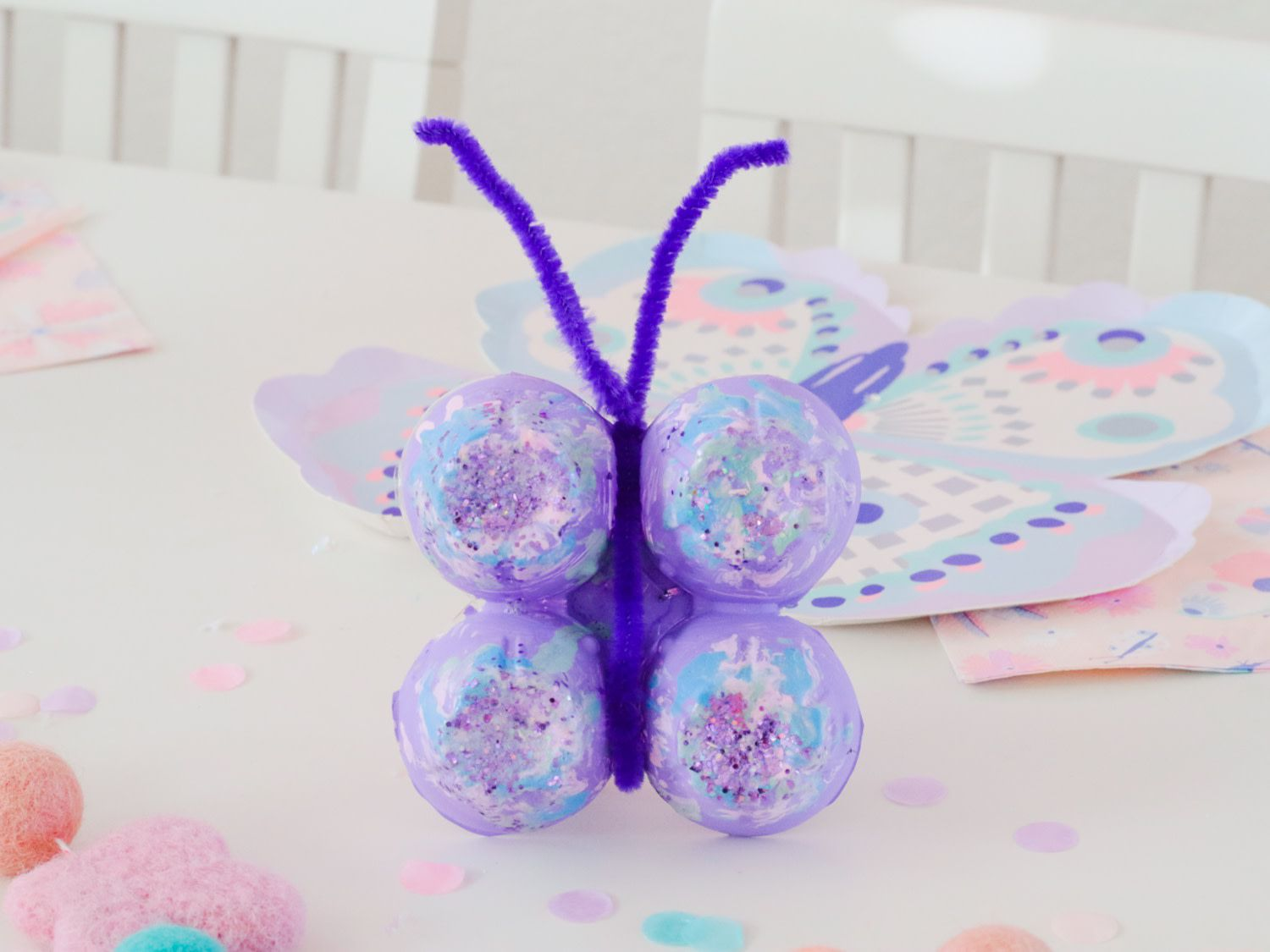 butterfly craft made out of an egg carton and pipe cleaners