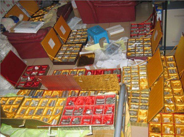 Thousands of fake coins struck by a Chinese counterfeiting ring in a box.