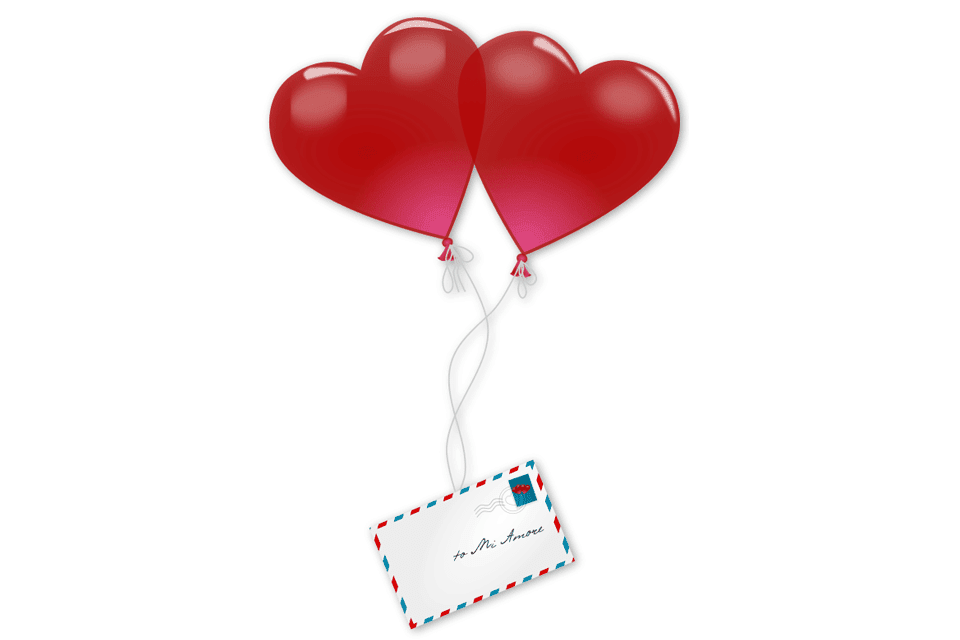 Two heart balloons holding an envelope