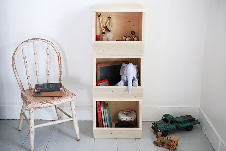 A wooden toy box and old chair