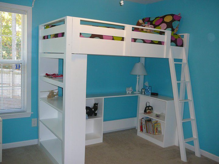 A Loft Bed With Desk And Bookcase