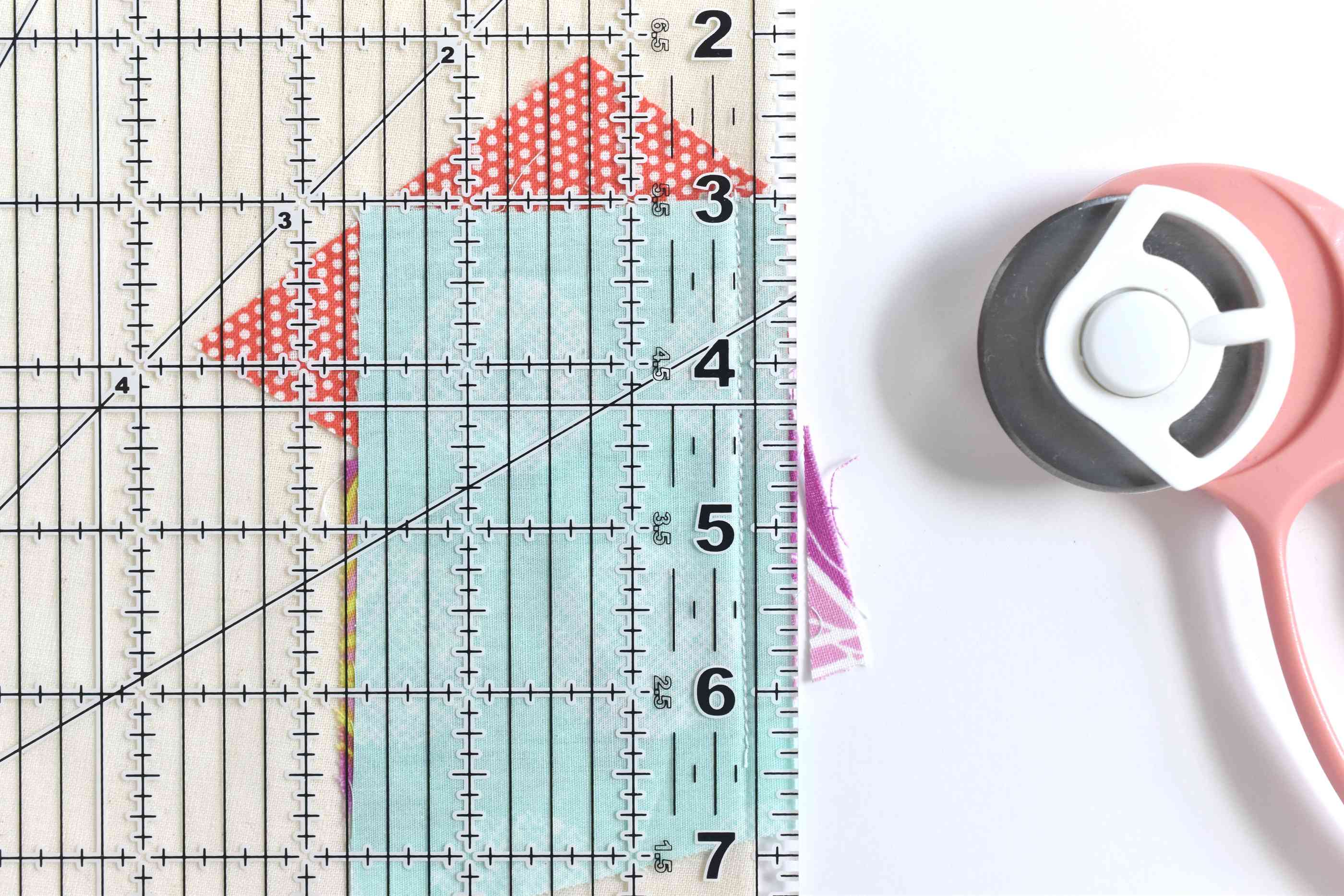 Pieces of fabric with a measuring template on top