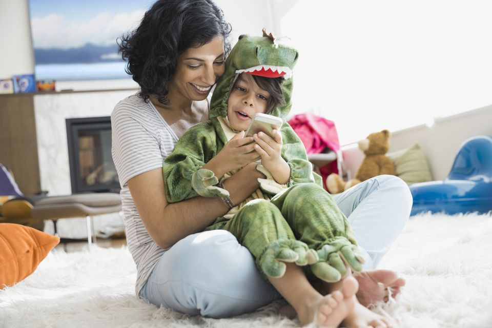 Mother holding son in dragon costume