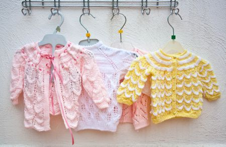 9435431e0a7 15 Free Baby Sweater Crochet Patterns