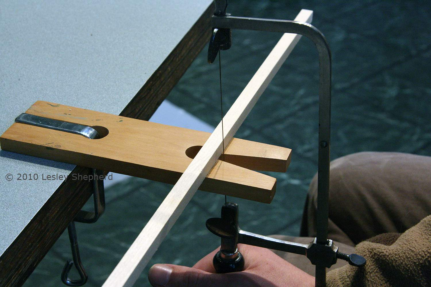 Jeweler's bench pin showing the position used for the saw and the material being braced.