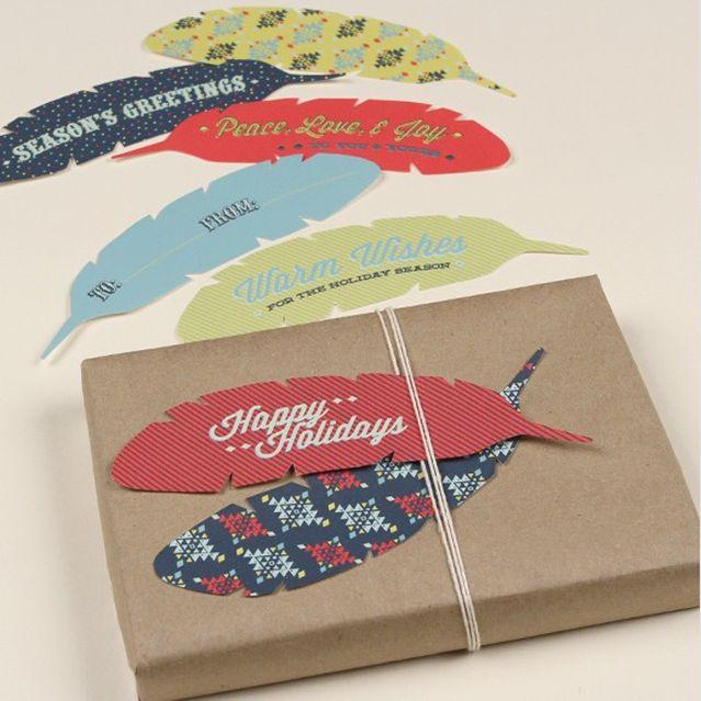 Christmas gift tags shaped like feathers.
