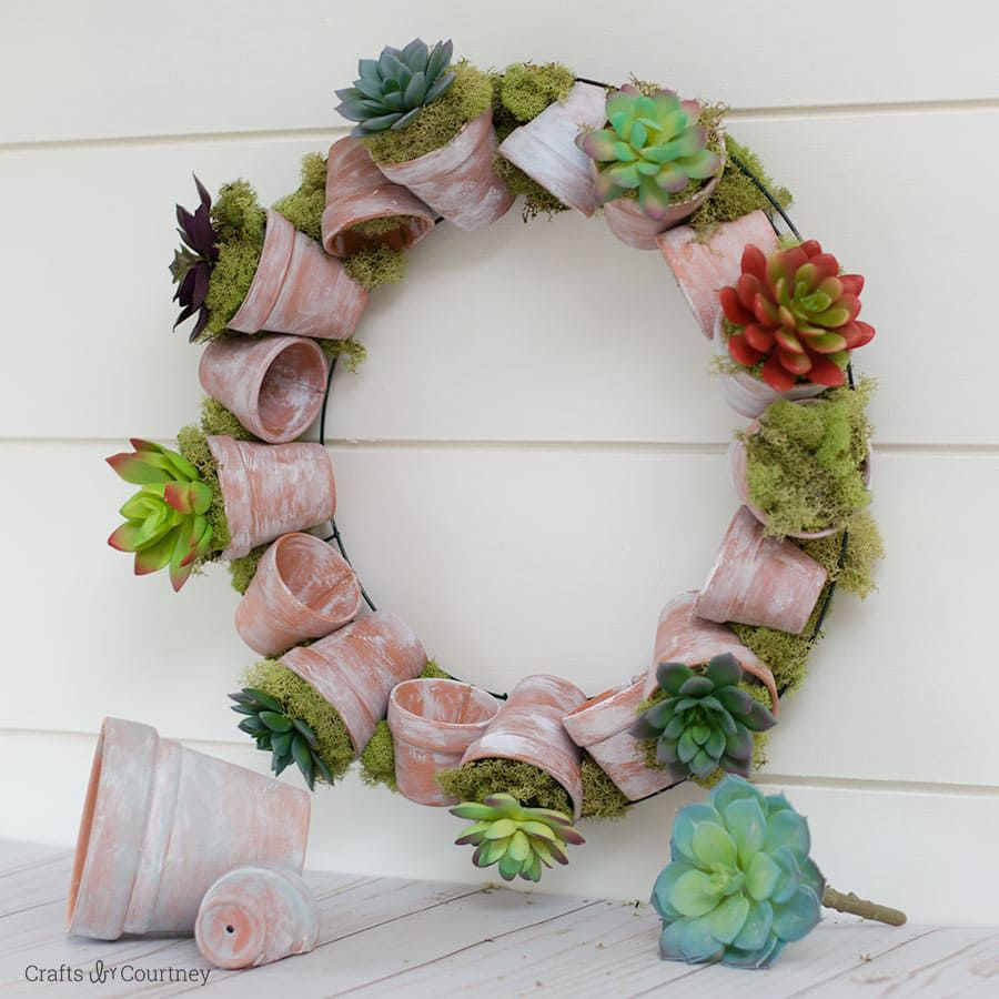 DIY succulent wreath on side of wall