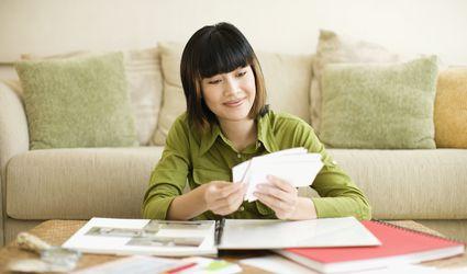 asian woman looking at photos