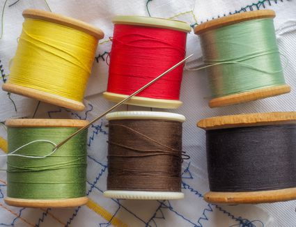 Colored Cottons and Sewing Needle