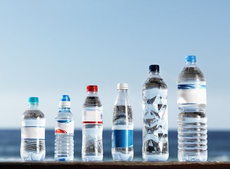 row of assorted water bottles with labels