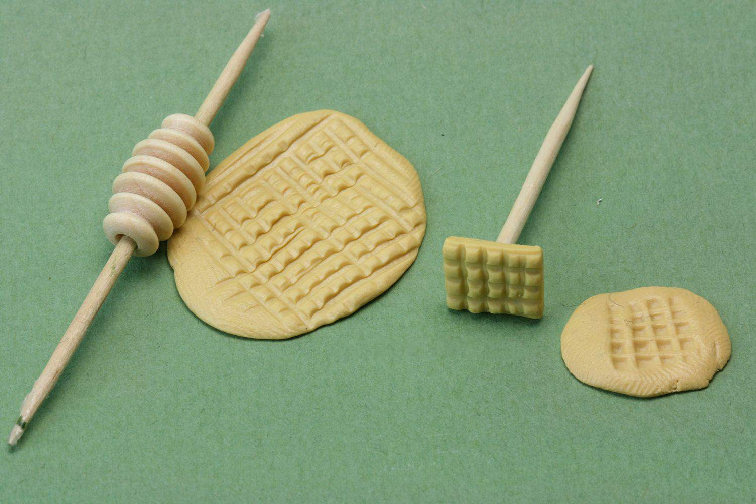 Ridged bead with a toothpick through the centre acts as a miniature rolling pin