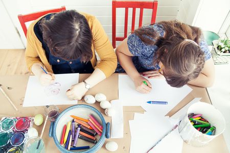 Overhead View Of Teenage Girl And Older Sister Painting Easter Eggs Cornelia Schauermann Getty Images These Egg Coloring Pages