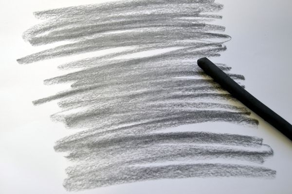 Scribbles on paper and a writing utensil.
