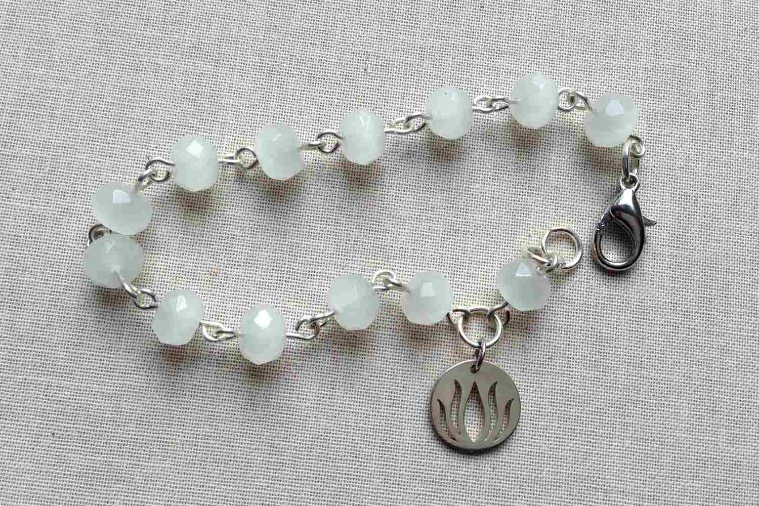 Rosary style bracelet with dangle
