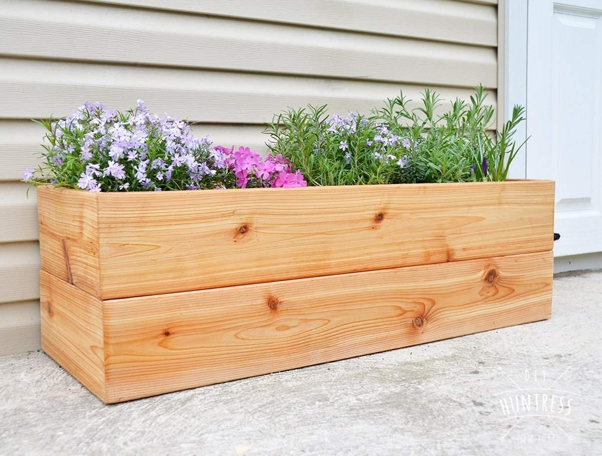 A cedar planter with flowers in it