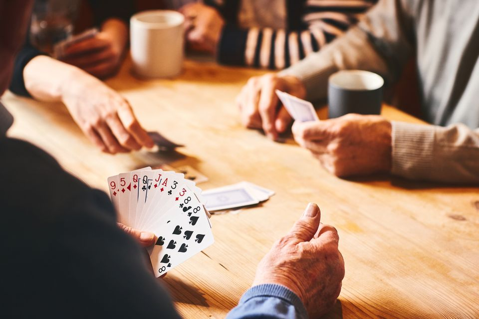 Senior people playing cards