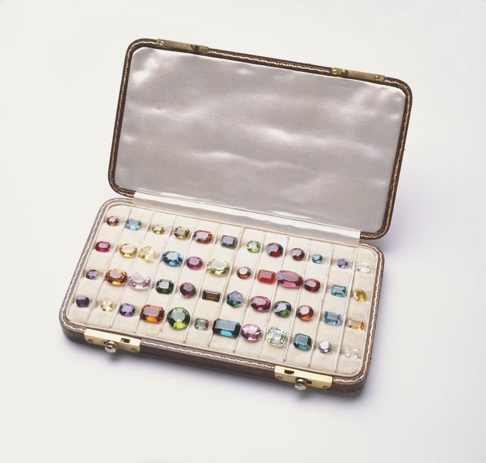 Case of colorful polished gemstones