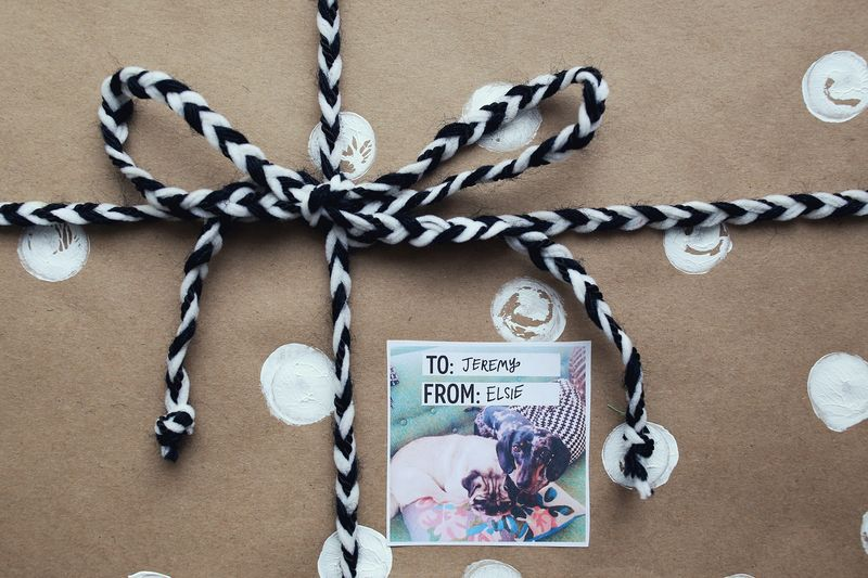 A brown paper and polka dot wrapped gifts