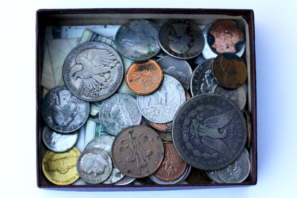Numismatic coins in a box