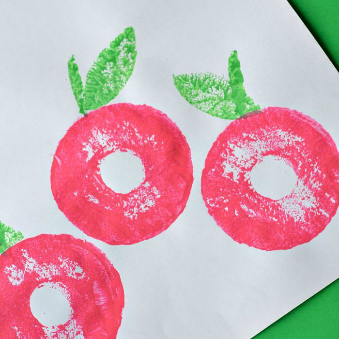 Apple craft paint stamping design used with pool noodles