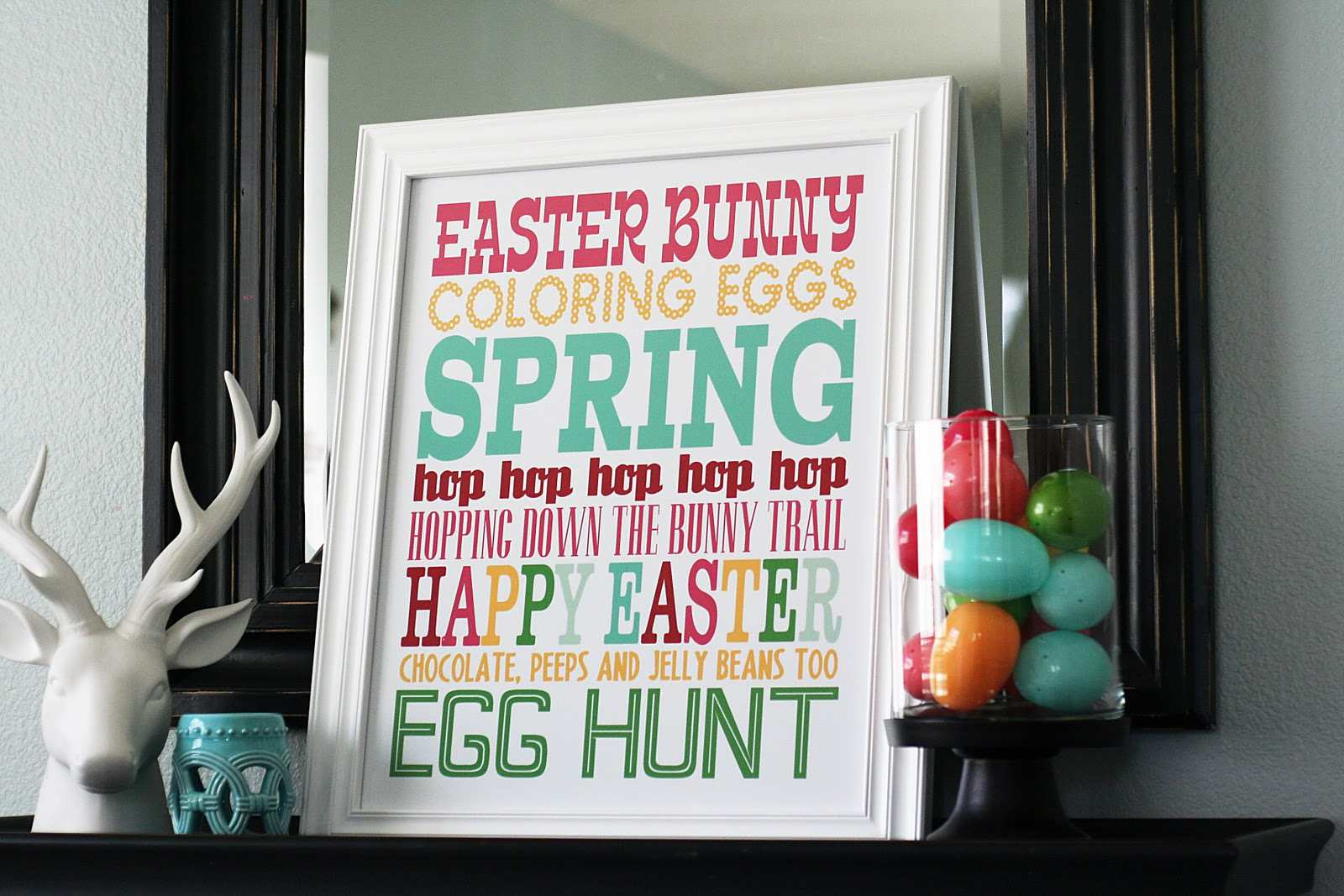 A colorful Easter subway printable on a mantle.