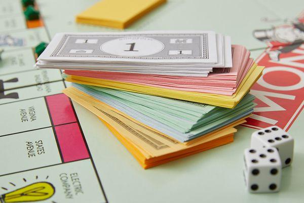 stack of Monopoly money