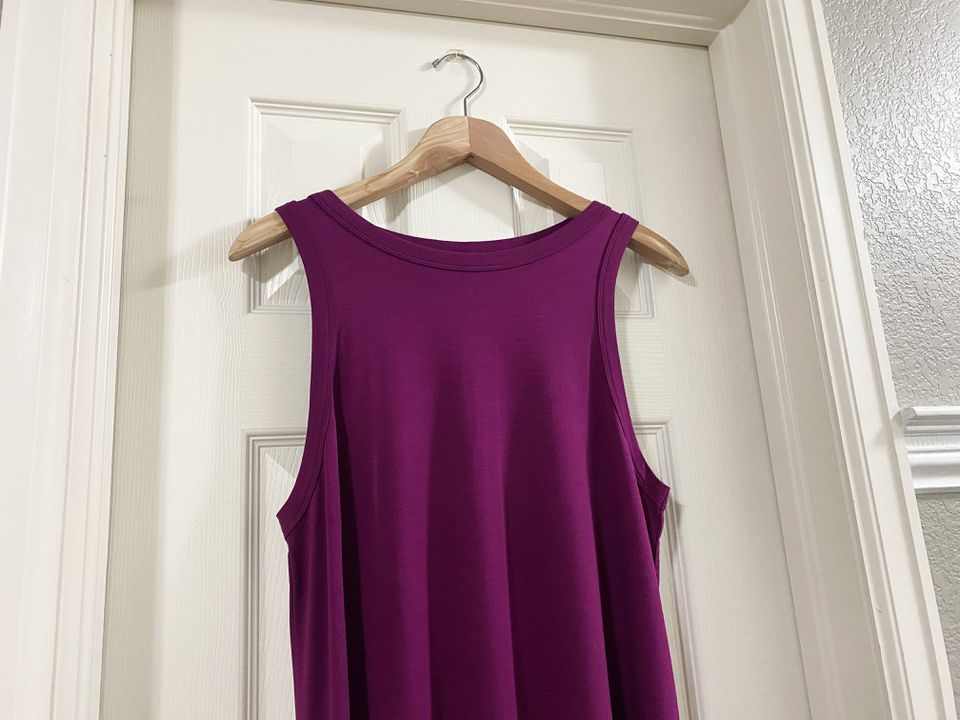 A purple dress hanging on a door