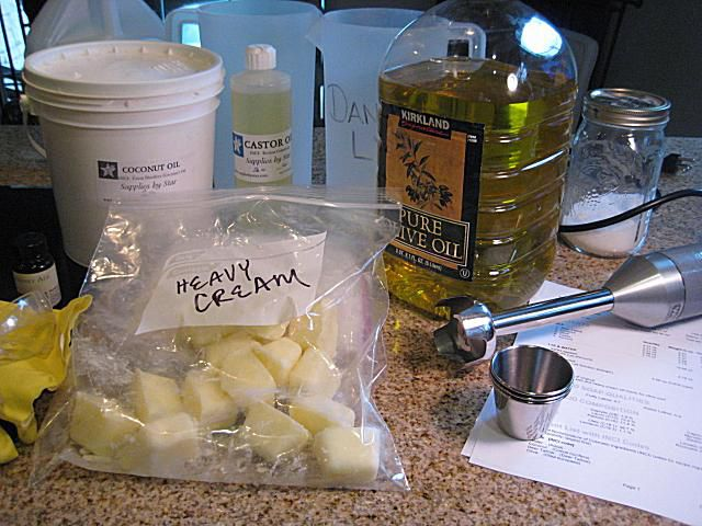 Setup, ingredients and tools for making milk soap with heavy cream