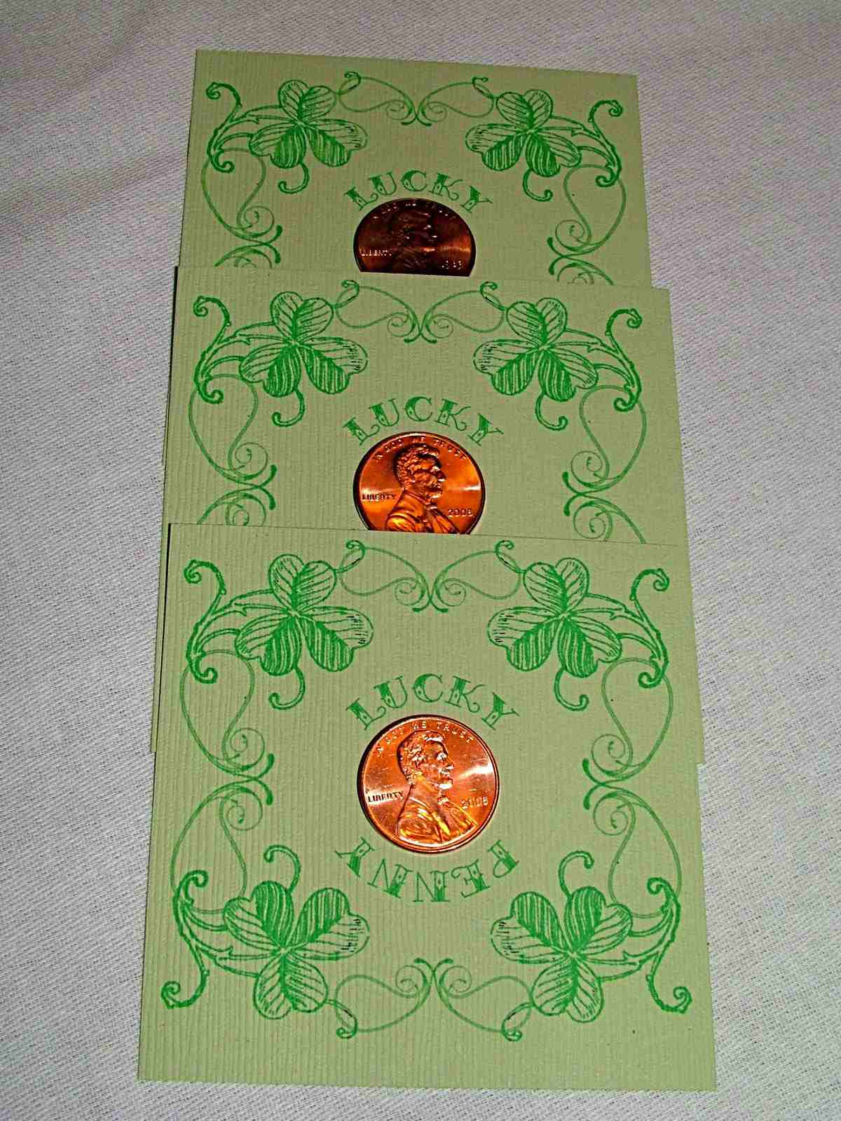 A St. Patrick's Day card with a penny stuck in the center.