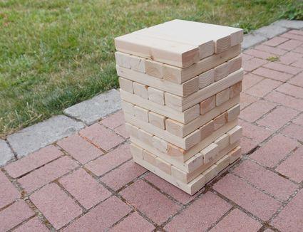 DIY giant Jenga set up on brick patio