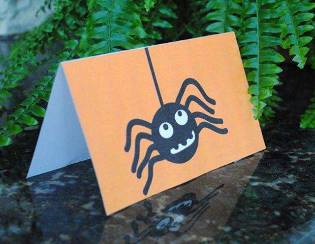 A spider on an orange Halloween card.