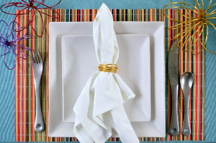 Napkin with napkin ring on a dinner plate