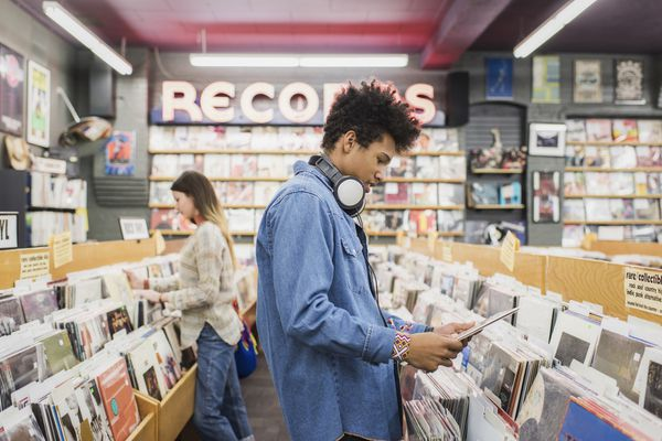 Teenage boy in a record store