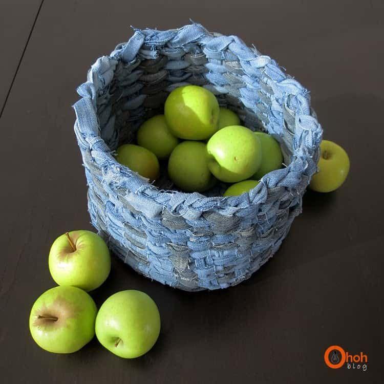 A basket made of denim, full of apples