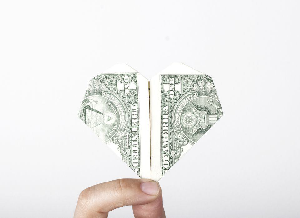 an origami heart made from a dollar