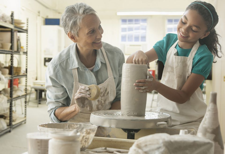 Grandmother and granddaughter doing pottery together