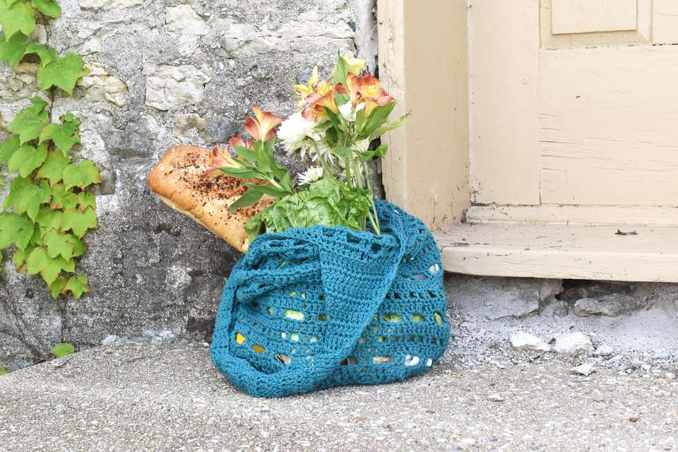 Crocheted Dots and Dashes Market Bag With Flowers and Bread Sticking Out