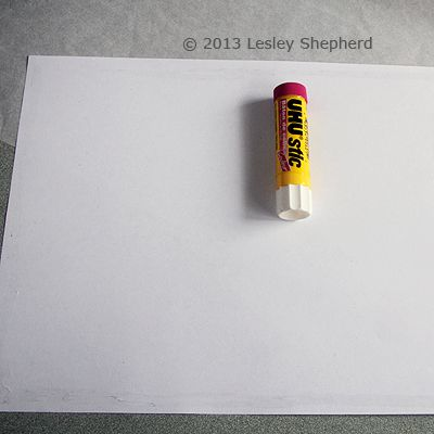 Gluing the edges of a sheet of backing paper