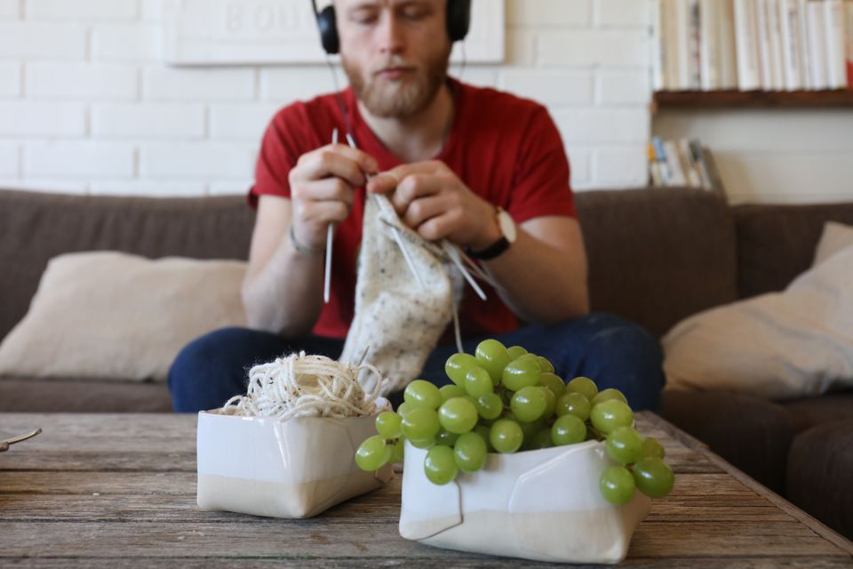 Man Knitting At Home