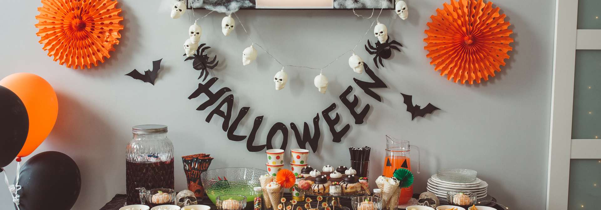 A Halloween themed party with food table and decorations