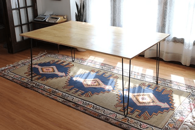 A Wooden Table on Top of a Rug