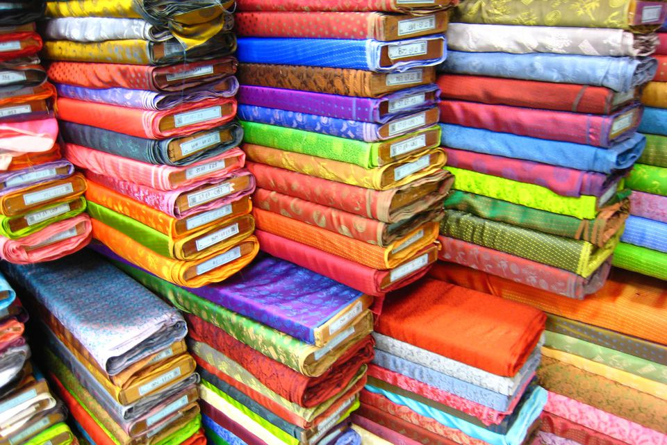 Stacked bolts of brightly colored fabric