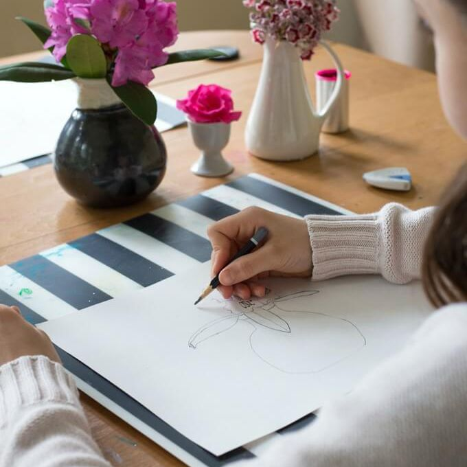 Girl doing an observational drawing of a flower