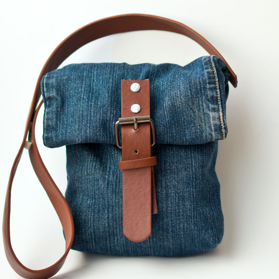 A jean purse with a leather strap