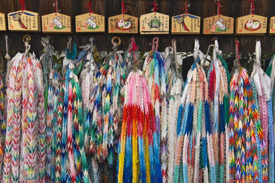 These senbazuru origami cranes with wishes are displayed in the Fushimi Inari Shrine