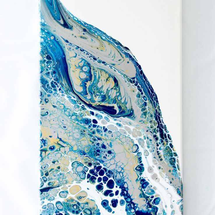 acrylic pouring painting hanging on a wall