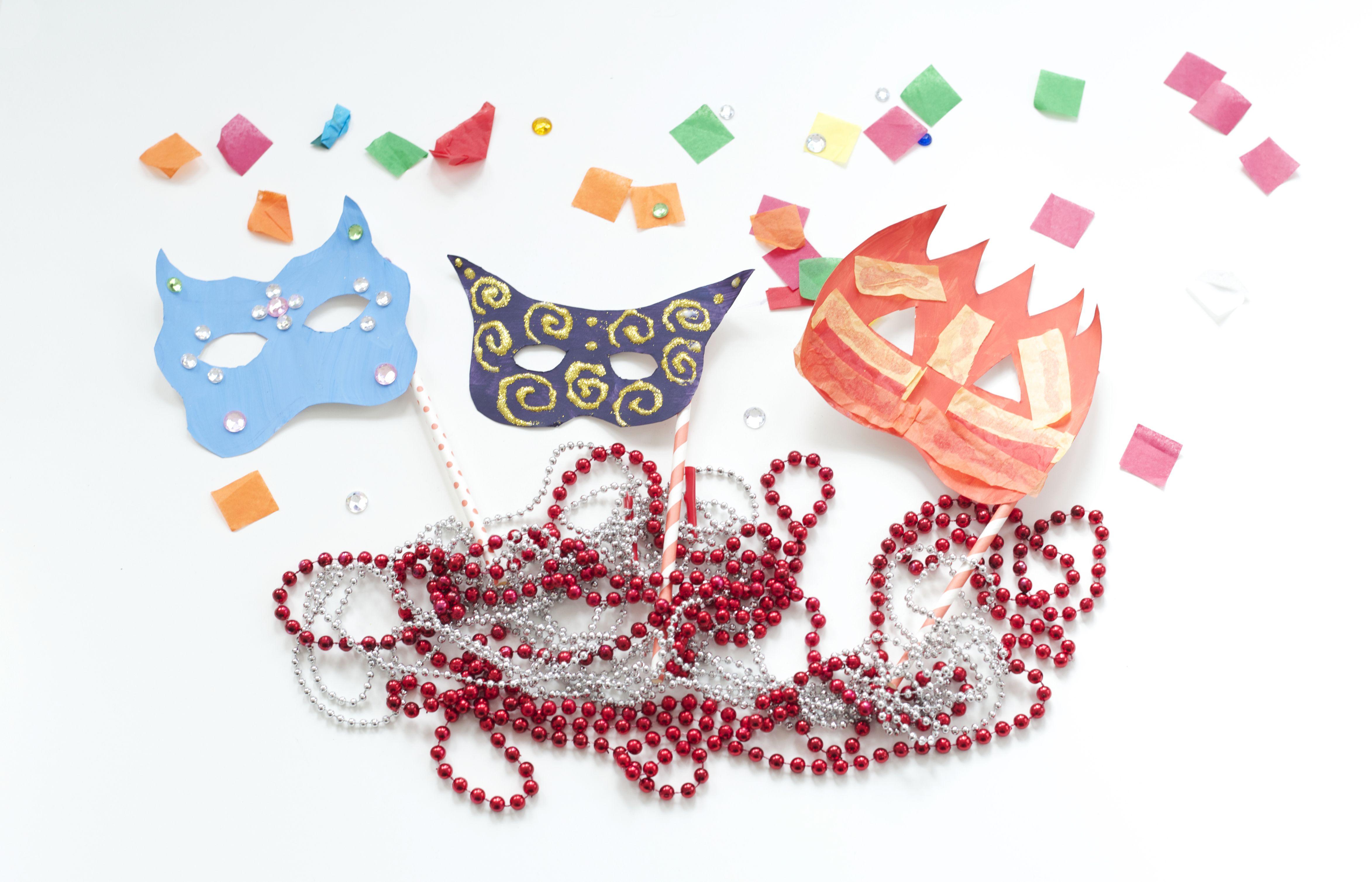 Mardi Gras-themed paper plate masks