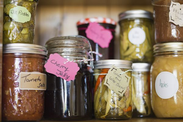 Homemade canned foods with handmade labels.